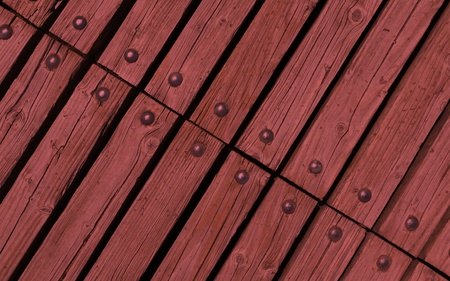 rivets: diagonal red wooden texture background with rivets close up