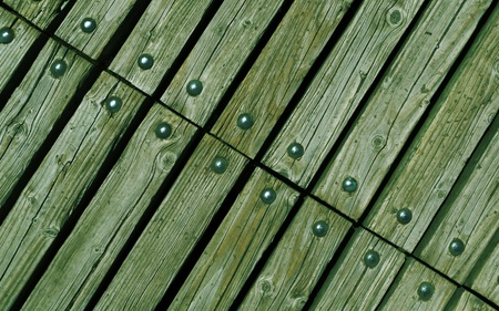 rivets: diagonal green wooden texture background with rivets close up Stock Photo