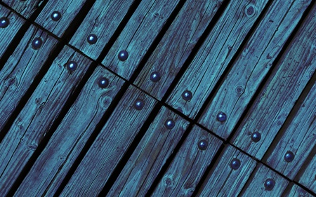 diagonal blue wooden texture background with rivets close up photo