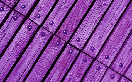 rivets: diagonal bright purple wooden texture background with rivets close up Stock Photo