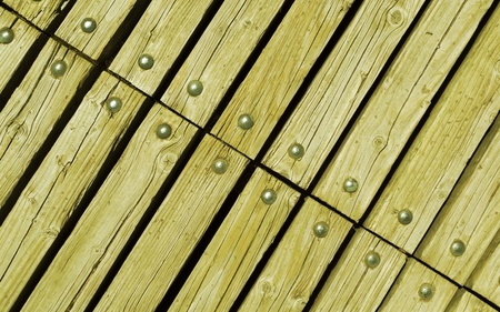 rivets: diagonal faded green wooden texture background with rivets close up