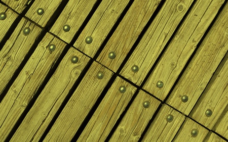 rivets: diagonal yellow wooden texture background with rivets close up Stock Photo