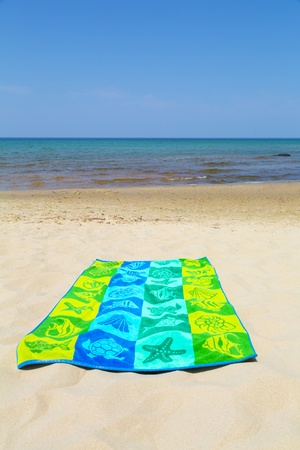 colorful towel on a beautiful beach photo