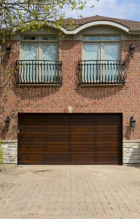 double brown wooden garage door 免版税图像