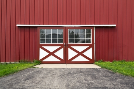 ruffle: double red barn steel door in the coutryside