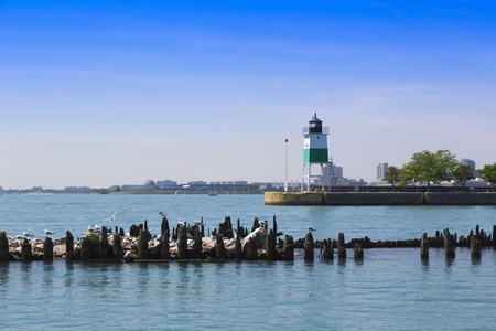 Chicago harbor lighthouse with breakwater in the summer