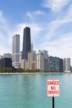 no swimming: Chicago skyline with no swimming area sign