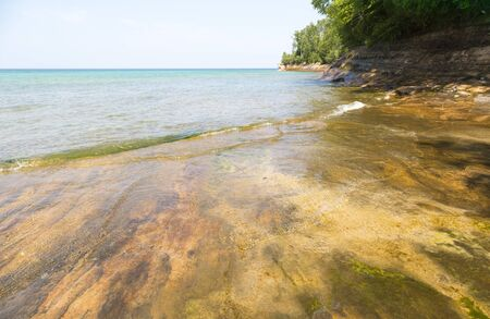 lakeshore: rocky lakeshore with forest in Munising, Michigan Stock Photo