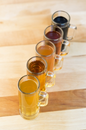 beer flight of five sampling mugs of light and dark craft beer Stock Photo - 21462919