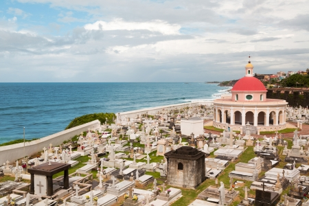 Historic waterfront Santa Maria Magdalena de Pazzis cemetery in San Juan, Puerto Rico with cloudy sky Stock Photo - 22954089