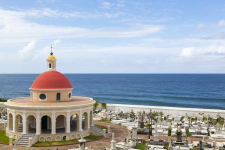 sacral: Historic waterfront Santa Maria Magdalena de Pazzis cemetery in San Juan, Puerto Rico with cloudy sky Stock Photo