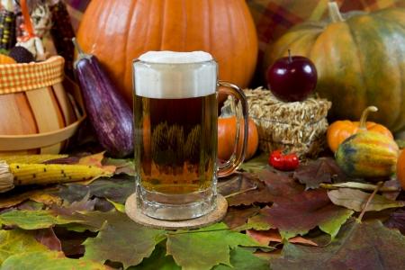 pilsner beer: oktoberfest lager beer mug with fall seasonal decoration