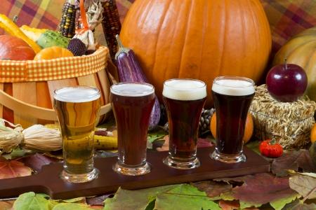 pilsner beer: oktoberfest beer flight of four samples with fall seasonal decoration