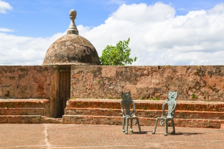 two funny cat shaped chairs standing in the sun by military fortress walls in San Juan, Puerto Rico Reklamní fotografie
