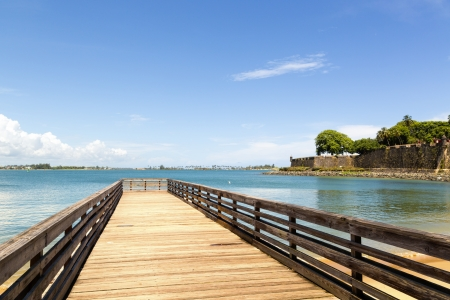 wooden pier with old fortification walls in San Juan, Puerto Rico