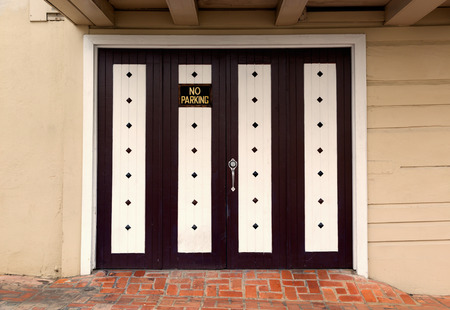 double white and brown wooden garage door with decorative studs photo