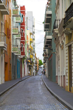 old towns: Charming Caribbean street in Old San Juan, Puerto Ricowith colorful buildings