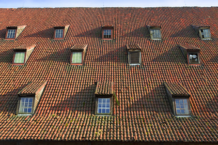 casement: old pitched red tile roof with tiny garret casement widows