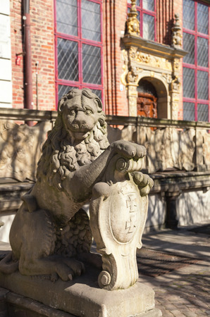 house coat: historic lion holding coat of arms in front of New House of the Court by Long Market in Gdansk, Poland