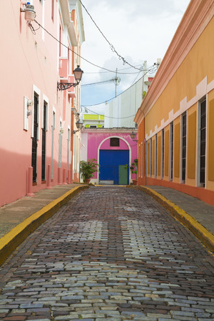 Charming dead end street with vivid colonial architecture and cobblestones in San Juan, Puerto Rico