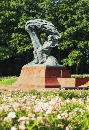 Chopin statue in Royal Lazienki Park in Warsaw, Poland with blossoming flowers