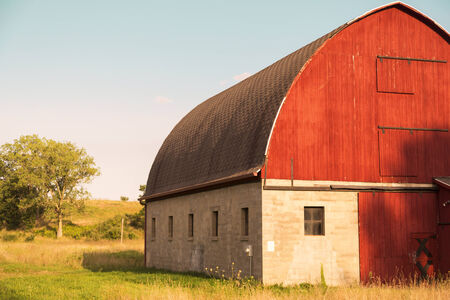 red barn in afternoon sun in the tranquil countryside