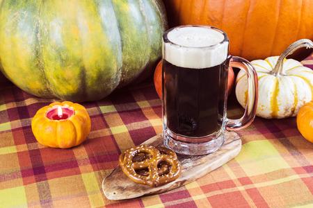 Oktoberfest seasonal pumpkin ale with fall decoration photo