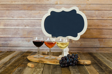 Wine flight with blank chalkboard sign and grapes Stok Fotoğraf