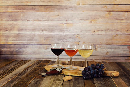 bottle opener: Wine flight on cutting board with grapes, cork and bottle opener