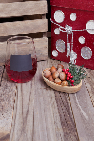 Holiday glass of red wine with cheerful decorations