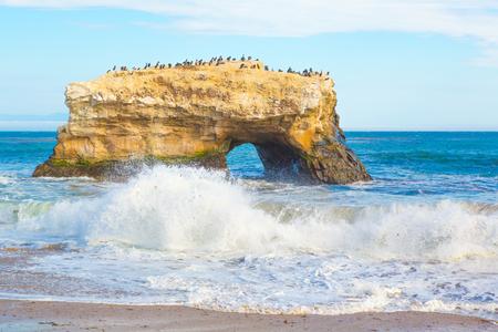 Natural arch rock by the beach in Santa Cruz, California