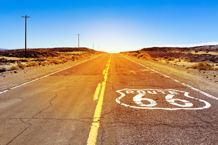Iconic Route 66 sign on the road in American desert land Stock Photo