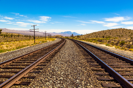 Railroad tracks going through Mojave Desert in California with beautiful view 版權商用圖片