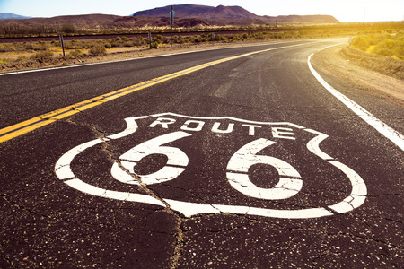 Iconic Route 66 sign on the road in American desert land 版權商用圖片