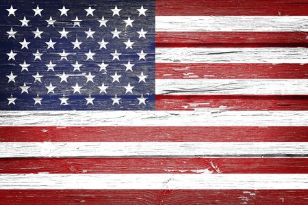 American flag with vintage look on grunge wooden background