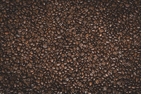 Rich brown roasted coffee beans background