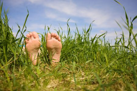 Barefooted a foot in a years grass Stock Photo - 3314342