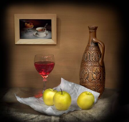 Still-life with a glass of wine and apples Stock Photo