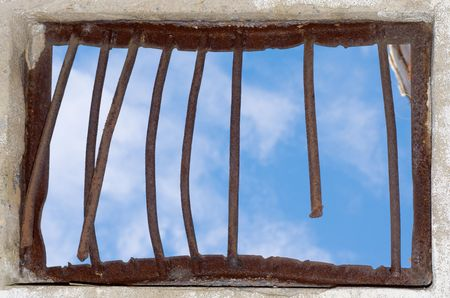 Old window closed by a rusty lattice photo