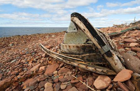 seacoast: The old, broken boat on seacoast Stock Photo