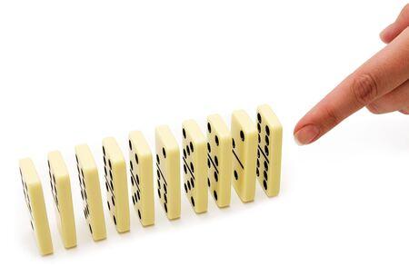 regimented: Bones of a dominoe preparing falling