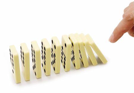 regimented: Bones of a dominoe have begun falling Stock Photo