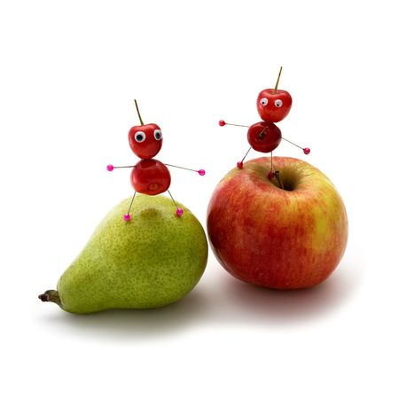 Two cheerful little men from a sweet cherry on fruit photo