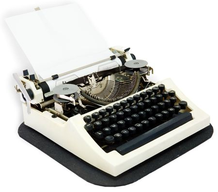 Typewriter with the inserted leaf of a paper in the carriage photo