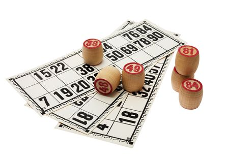 Wooden kegs with pink figures on game cards photo