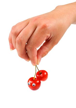 Female hand holding two sweet cherry with eyes Stock Photo - 3375640