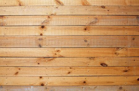 panelling: The surface of yellow rough wooden wall