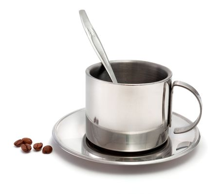 Metal coffee cup with a spoon and coffee grains on a white background photo