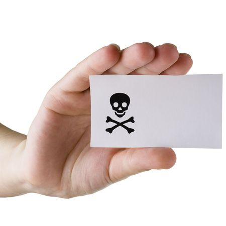 cutaway drawing: Paper card with the image black jolly Roger in a hand on a white background