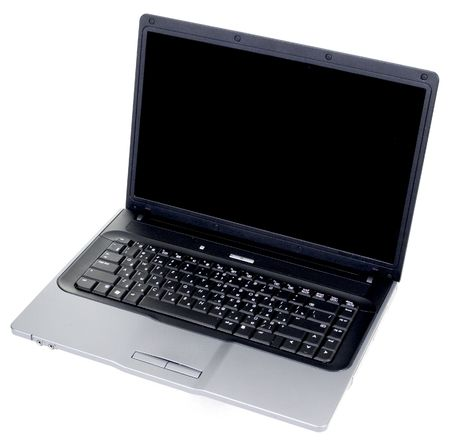 The old black laptop with the Russian keyboard on a white background Stock Photo - 3654933